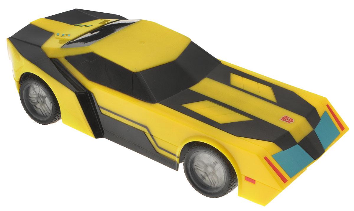 Dickie Toys Машина на радиоуправлении Bumblebee3114000Машина на радиоуправлении Dickie Toys Bumblebee со световыми эффектами непременно понравится любому поклоннику трансформеров. Машина выполнена из безопасного и прочного материала. С помощью пульта управления машина может двигаться вперед-влево-вправо, назад-влево-вправо, останавливаться, а также имеется функция - турбо. Особую реалистичность игре с Бамблби придает неоновая подсветка дисков. Игрушка станет главным действующим лицом увлекательной игры по сюжету мультфильма или ребенок сможет придумать новую историю, проявив свою фантазию. Порадуйте своего ребенка таким замечательным подарком! Для работа машины необходимо купить 3 батарейки напряжением 1,5V типа АА (не входят в комплект). Для работы пульта управления необходимо купить 3 батарейки напряжением 1,5V типа AAA (не входят в комплект). Пульт управления работает на частоте 2,4 GHz.