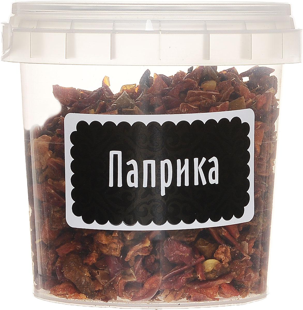 Компас Здоровья Паприка красная сладкая, 35 гУТ000001030Паприка - это нарезанный кусочками (или смолотый в порошок), высушенный красный стручковый перец, обладающий вкусом и ароматом свежего. Вкус этой специи сладковатый, слегка жгучий, с едва уловимой ноткой горчинки. Паприка очень популярна в немецкой, венгерской, мексиканской, испанской, азиатской кухнях. Её добавляют в блюда из мяса, курицы, рыбы, риса, сочетают с томатом, сметаной, картофелем, базиликом, чесноком, мускатным орехом. Не рекомендуется сильно нагревать паприку в масле так как она может стать горькой из-за содержащегося в ней сахара (он может подгореть). Так как паприка - это теплая, жгучая приправа, она обладает кроворазжижающим свойством. Кроме того, она стимулирует пищеварение, имеет лёгкий обезболивающий эффект, повышает мозговую активность.