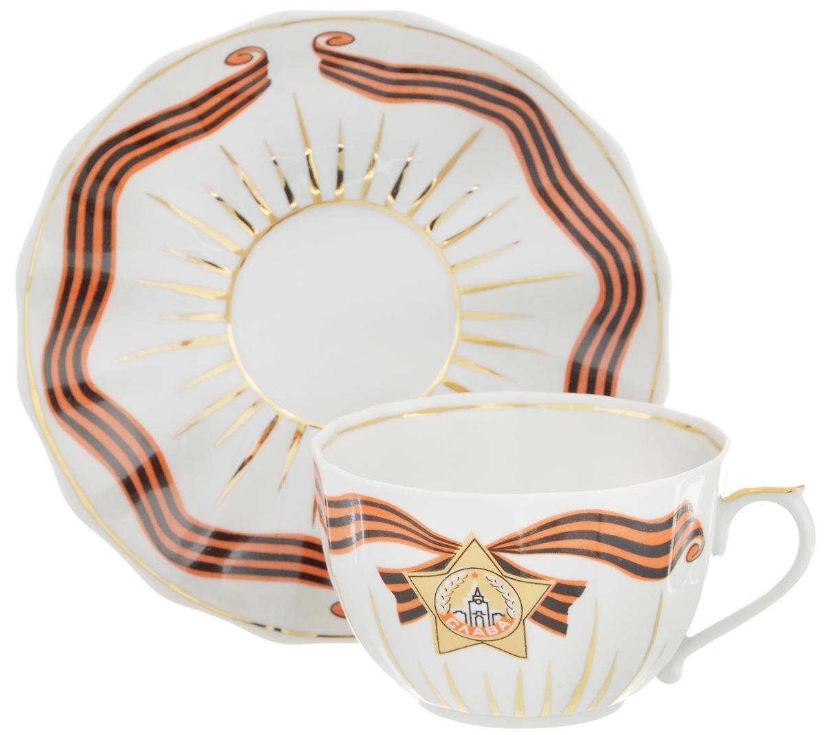 Чайная пара Фарфор Вербилок Слава, 2 предмета3918400ПЧайная пара Фарфор Вербилок Слава состоит из чашки и блюдца, изготовленных из высококачественного фарфора. Оригинальный дизайн, несомненно, придется вам по вкусу. Чайная пара Фарфор Вербилок Слава украсит ваш кухонный стол, а также станет замечательным подарком к любому празднику. Диаметр чашки (по верхнему краю): 8,7 см. Высота чашки: 5,7 см. Диаметр блюдца: 14,5 см. Высота блюдца: 2,5 см.