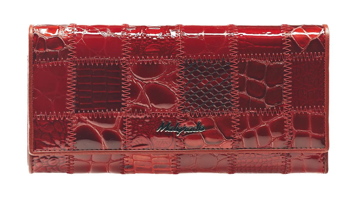 Кошелек женский Malgrado, цвет: красный. 72032-3A-444A72032-3A-444A RedСтильный кошелек Malgrado изготовлен из натуральной кожи красного цвета с декоративным комбинированным тиснением и вмещает в себя купюры в развернутом виде в полную длину. Внутри содержит четыре отделения для купюр, одно из которых на молнии, восемь отделений для дисконтных карт, визиток, кредиток, один прозрачный кармашек, в который можно положить пропуск, проездной документ или фотографию, отделение для мелочи, закрывающиеся на металлический замок и дополнительный потайной карман. Закрывается кошелек клапаном на кнопку. Кошелек упакован в подарочную металлическую коробку с логотипом фирмы. Такой кошелек станет замечательным подарком человеку, ценящему качественные и практичные вещи. Характеристики: Материал: натуральная кожа, текстиль, металл. Размер кошелька: 18,5 см х 9 см х 3 см. Цвет: черный. Размер упаковки: 23 см х 13 см х 4,5 см. Артикул: 72032-3A-444A Red.