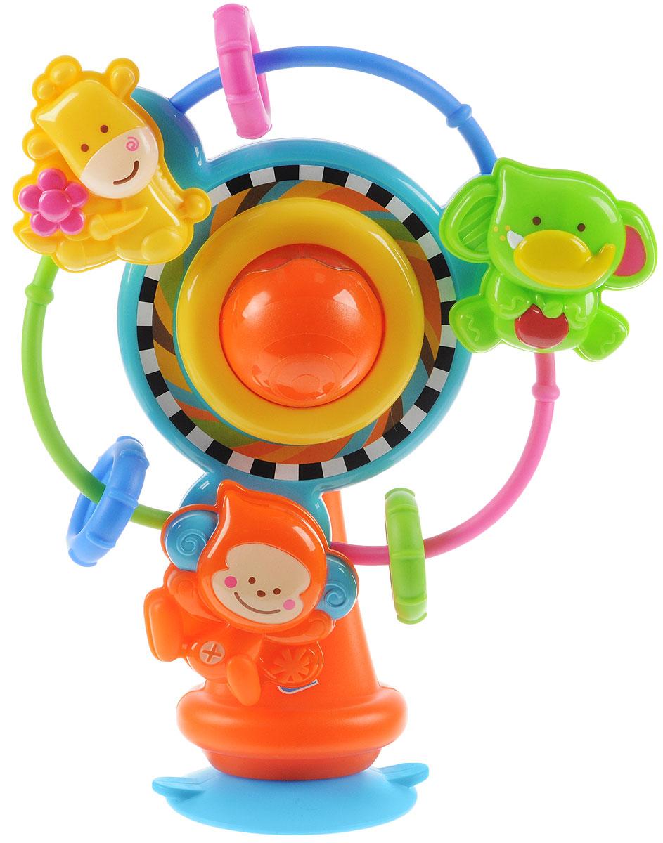 B kids Развивающая игрушка Карусель004644B, 004644Игрушка на присоске Карусель - многофункциональное развлечение для ребенка, которое можно закрепить на любой ровной горизонтальной поверхности. Благодаря яркому дизайну и нескольким точкам активности такая карусель надолго займет малыша. Диск карусели вращается, на нем есть и три колечка, которые можно передвигать по прутикам и три игрушки - слоненок, обезьяна и жираф. Игрушки так же вращаются вокруг своей оси. В центре карусели находится шар, заполненный маленькими разноцветными шариками: поверните его, и вы услышите негромкий звук погремушки. Игрушка B kids поможет ребенку в развитии цветового и звукового восприятия, мелкой моторики рук и координации движений. Игрушка рассчитана на детей старше 6 месяцев.