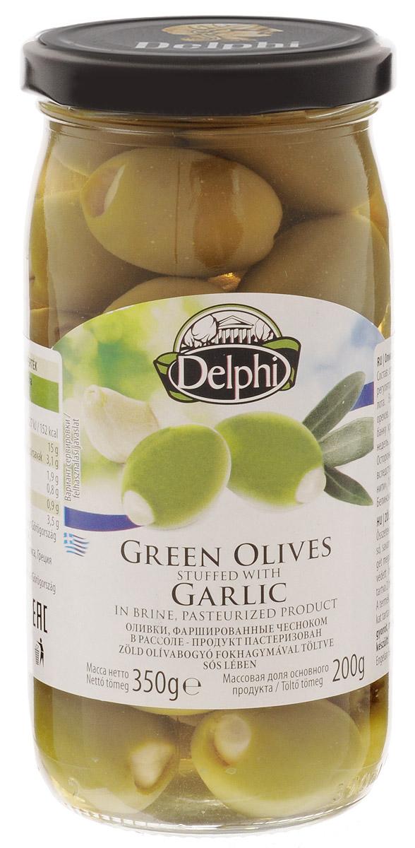 Delphi Оливки фаршированные чесноком, 350 г51.0023Зеленые оливки с хрустящим чесноком в рассоле имеют пикантный оливково-чесночный вкус, аромат которого довольно сбалансирован. Чеснок остается таким же хрустящим, а оливки придают ему мягкость. Вместе они составляют удачную комбинацию и станут хорошим дополнением к напиткам, но могут пригодиться и отдельно в качестве легкой закуски.