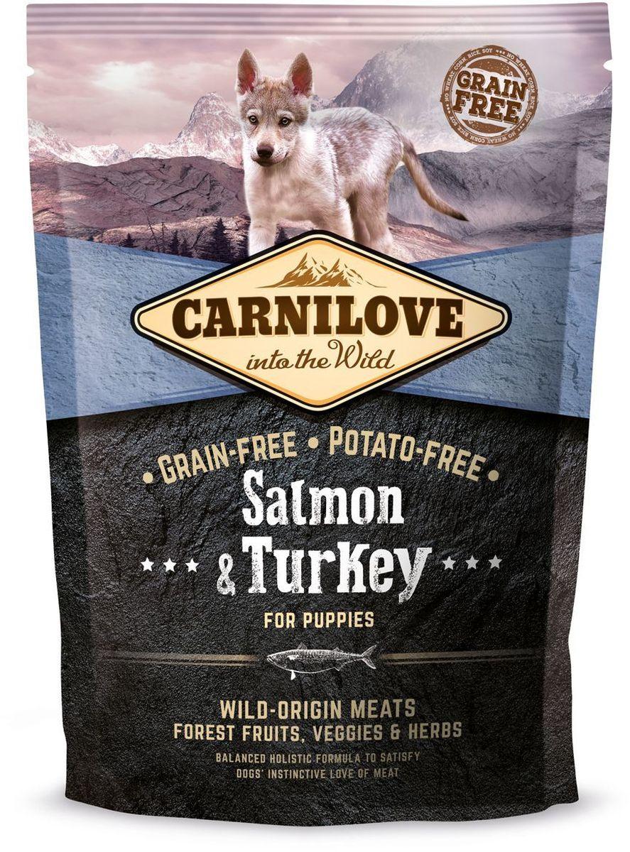Корм сухой Carnilove, для щенков, беззерновой, с лососем и индейкой, 1,5 кг150822Сбалансированный полнорационный сухой беззерновой корм для щенков крупных пород (? 25 кг, 3 – 30 месяцев). Cостав: мука из лосося (25%), мука из индейки (20%), желтый горох (18%), куриный жир (консервирован токоферолами, источником витамина е, 9%), цельные яйца (5%), гидролизованный куриный протеин (5%), крахмал из тапиоки (5%), яблоки (3%), куриная печень (3%), рыбий жир лососевый (2%), морковь (1%), льняное семя (1%), нут (1%), гидролизованные панцири ракообразных (источник глюкозамина, 0,031%), экстракт хряща (источник хондроитина, 0,019%), пивные дрожжи (источник маннан-олигосахаридов, 0,018%), корень цикория (источник фрукто-олигосахаридов, 0,012%), юкка шидигера (0,011%), водоросли (0,01%), псиллиум (0,01%), тимьян (0,01%), розмарин (0,01%), орегано (0,01%), клюква (0,0008%), голубика (0,0008%), малина (0,0008%).