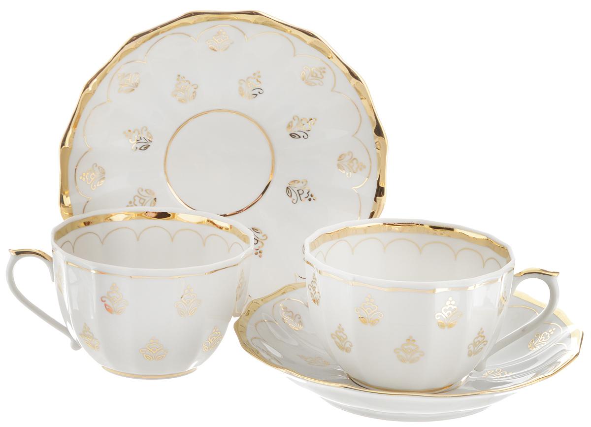 Набор чайный Фарфор Вербилок Королевский, 4 предмета2057780ПЧайный набор Фарфор Вербилок Королевский состоит из 2 чашек и 2 блюдец, которые изготовлены из высококачественного фарфора и украшены красивым рисунком. Несмотря на то, что фарфор легкий и тонкий, он отличается необычайной прочностью и долговечностью. Изысканный утонченный дизайн придется по вкусу ценителям классики и тем, кто предпочитает современный стиль. Чайный набор Королевский украсит ваш кухонный стол, а также станет замечательным подарком к любому празднику. Диаметр чашки (по верхнему краю): 8,5 см. Высота чашки: 5,5 см. Диаметр блюдца: 14,5 см. Высота блюдца: 2,5 см.