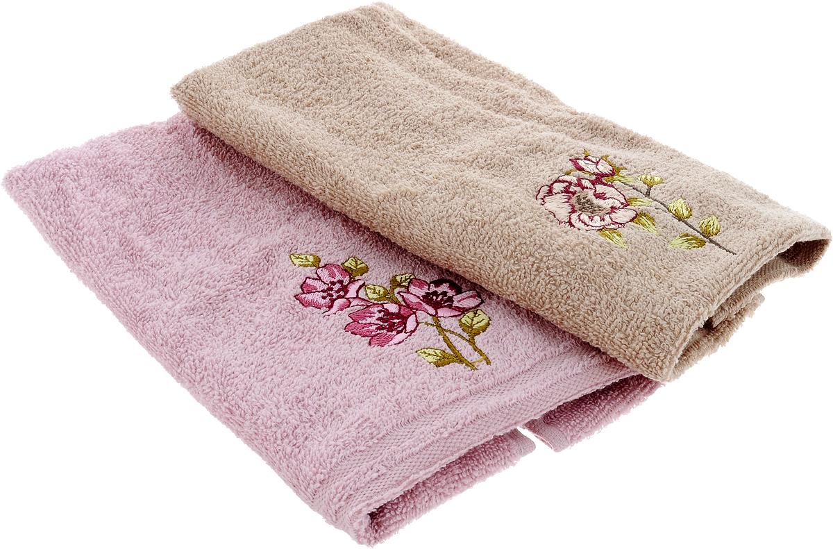Набор кухонных полотенец Karna Santa, цвет: бежевый, светло-розовый, 30 х 50 см, 2 шт717/CHAR003Набор Karna Santa состоит из 2 прямоугольных полотенец, которые выполнены из высококачественного хлопка и украшены вышивкой. Изделия гипоаллергенны, отлично впитывают влагу, быстро сохнут, сохраняют цвет и не теряют форму даже после многократных стирок. Такие полотенца очень практичны и неприхотливы в уходе. Набор Karna станет отличным помощником и украсит интерьер вашей кухни.