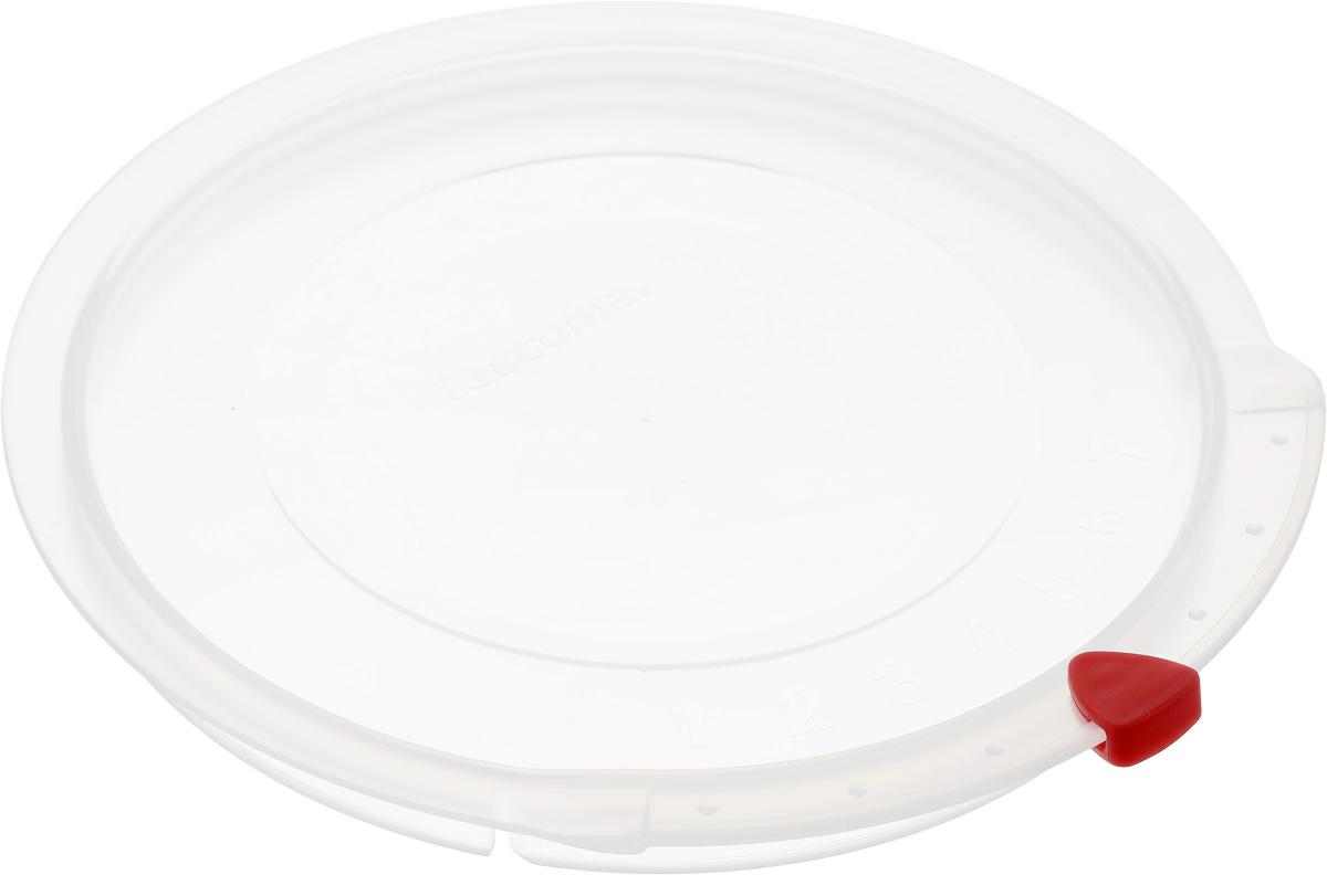 Крышка Tescoma Unicover, диаметр 16 см782816Крышка Tescoma Unicover используется при хранении еды, для закрытия высоких кастрюль, кастрюль и ковшей из нержавеющей стали. Плоская форма крышки позволяет складывать посуду в целях экономии места в холодильнике. Пища, закрытая пластиковой крышкой, не высыхает и не впитывает запахи других продуктов питания. На крышке имеется семидневный датировщик для индикации с первого дня хранения. Изделие выполнено из пластмассового материала, предназначенного для медицинских и фармацевтических целей. Можно мыть в посудомоечной машине. Подходит для кастрюль диаметром 16 см. Диаметр крышки (по верхнему краю): 17,5 см.
