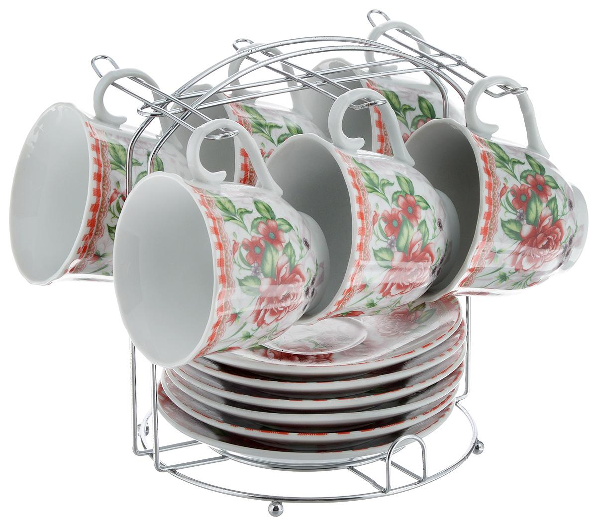 Набор чайный Bella, 13 предметов. DL-F6MS-192DL-F6MS-192Набор Bella состоит из 6 чашек и 6 блюдец, изготовленных из высококачественного фарфора. Чашки оформлены красочным рисунком. Изделия расположены на металлической подставке. Такой набор подходит для подачи чая или кофе. Изящный дизайн придется по вкусу и ценителям классики, и тем, кто предпочитает современный стиль. Он настроит на позитивный лад и подарит хорошее настроение с самого утра. Чайный набор Bella - идеальный и необходимый подарок для вашего дома и для ваших друзей в праздники. Объем чашки: 220 мл. Диаметр чашки (по верхнему краю): 8 см. Высота чашки: 7 см. Диаметр блюдца: 14 см. Высота блюдца: 2,3 см. Размер подставки: 17 х 16,5 х 19 см.