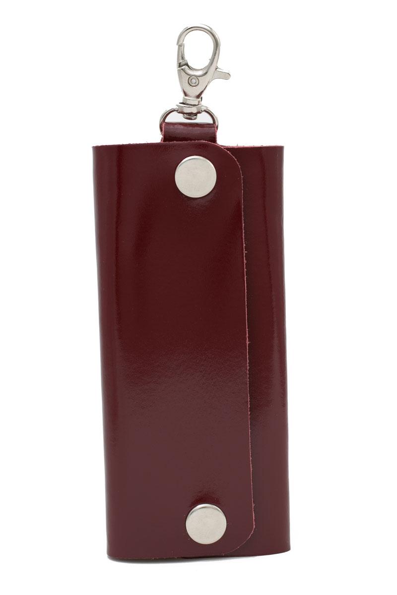 Ключница Mitya Veselkov, цвет: темно-коричневый. SPEKTR-KLYUCH-BROWNSPEKTR-KLYUCH-BROWNКлючница Mitya Veselkov выполнена из натуральной гладкой кожи. Изделие закрывается с помощью кнопок. Внутри расположена металлическая панель с шестью фиксаторами для ключей. Ключница оснащена замком-карабином, с помощью которого изделие можно фиксировать на одежду.