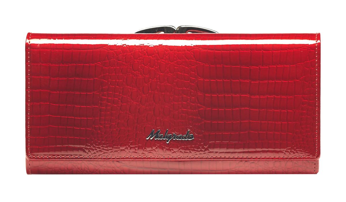 Кошелек женский Malgrado, цвет: красный. 72031-3-4472031-3-44Стильный кошелек Malgrado изготовлен из натуральной кожи красного цвета с декоративным тиснением под рептилию и вмещает в себя купюры в развернутом виде в полную длину. Внутри содержит четыре отделения для купюр, одно из которых на молнии, четыре кармана для дисконтных карт, визиток, кредиток, один прозрачный кармашек, в который можно положить пропуск, проездной документ или фотографию и дополнительный потайной карман. Снаружи расположен один отдел для мелочи, который закрывается на рамочный замок. Закрывается кошелек клапаном на кнопку. Кошелек упакован в подарочную металлическую коробку с логотипом фирмы. Такой кошелек станет замечательным подарком человеку, ценящему качественные и практичные вещи. Характеристики: Материал: натуральная кожа, текстиль, металл. Размер кошелька: 18,5 см х 9 см х 3 см. Цвет: красный. Размер упаковки: 23 см х 13 см х 4,5 см. Артикул: 72031-3-44.