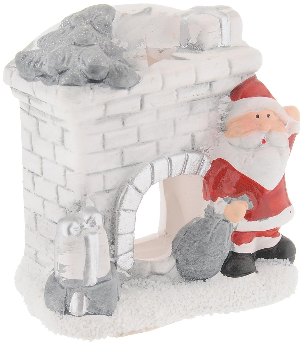 Подсвечник House & Holder Камин, 9 х 4,5 х 9 смDP-B28-13545Подсвечник House & Holder Камин выполнен из стекла в виде камина с Дедом Морозом. В подсвечнике имеется специальное место для чайной свечки. Изделие будет прекрасно смотреться на праздничном столе. Новогодние украшения несут в себе волшебство и красоту праздника. Они помогут вам украсить дом к предстоящим праздникам и оживить интерьер по вашему вкусу. Создайте в доме атмосферу тепла, веселья и радости, украшая его всей семьей.