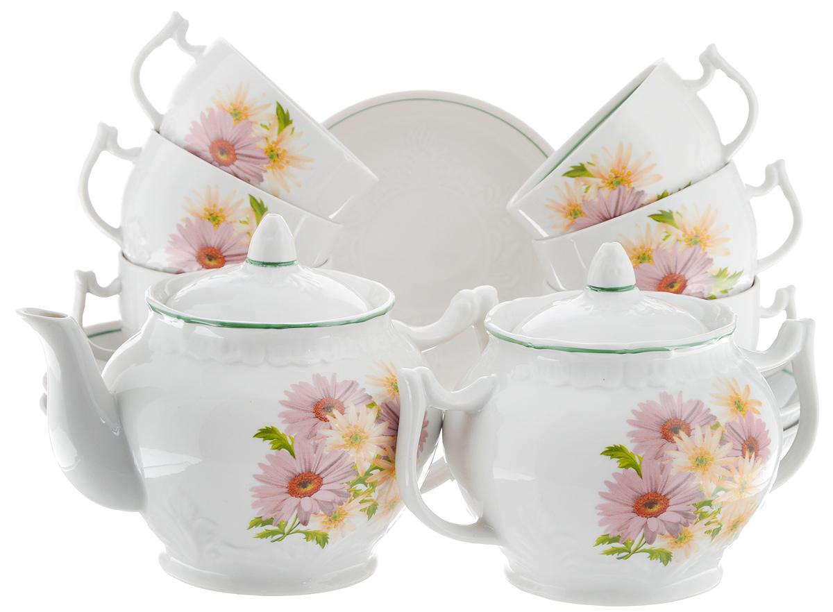 Сервиз чайный Фарфор Вербилок Розовые герберы, 14 предметов4671660Чайный сервиз Фарфор Вербилок Розовые герберы состоит из 6 чашек, 6 блюдец, сахарницы и заварочного чайника. Изделия выполнены из высококачественного фарфора и оформлены цветочным рисунком. Изящный чайный сервиз прекрасно оформит стол к чаепитию и порадует вас элегантным дизайном и качеством исполнения. Объем чайника: 600 мл. Высота чайника (без учета крышки): 10,5 см. Диаметр чайника (по верхнему краю): 6,5 см. Высота сахарницы (без учета крышки): 8,5 см. Диаметр сахарницы (по верхнему краю): 6,5 см. Объем сахарницы: 500 мл. Объем чашки: 300 мл. Диаметр чашки (по верхнему краю): 8 см. Высота чашки: 5,5 см. Диаметр блюдца: 14 см. Высота блюдца: 2,3 см.