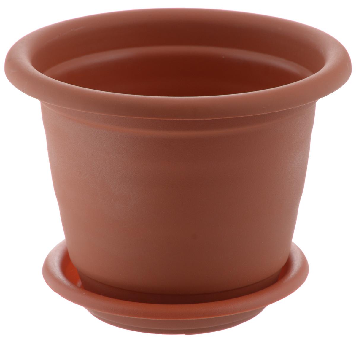 Кашпо Idea Ламела, с поддоном, цвет: терракотовый, 800 млМ 8200Кашпо Idea Ламела изготовлено из высококачественного пластика. Специальный поддон предназначен для стока воды. Изделие прекрасно подходит для выращивания растений и цветов в домашних условиях. Лаконичный дизайн впишется в интерьер любого помещения. Диаметр поддона: 11 см. Диаметр кашпо по верхнему краю: 13 см. Высота кашпо: 11 см. Объем кашпо: 800 мл.