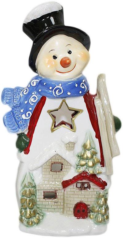 Подсвечник Lillo, цвет: красный, белый, синий, высота 24 см. 2011120820111208Подсвечник Lillo, выполненный из керамики, украсит интерьер вашего дома или офиса. Оригинальный дизайн и красочное исполнение создадут праздничное настроение. Подсвечник выполнен в форме снеговика. Вы можете поставить подсвечник в любом месте, где он будет удачно смотреться, и радовать глаз. Кроме того - это отличный вариант подарка для ваших близких и друзей в преддверии Нового года.