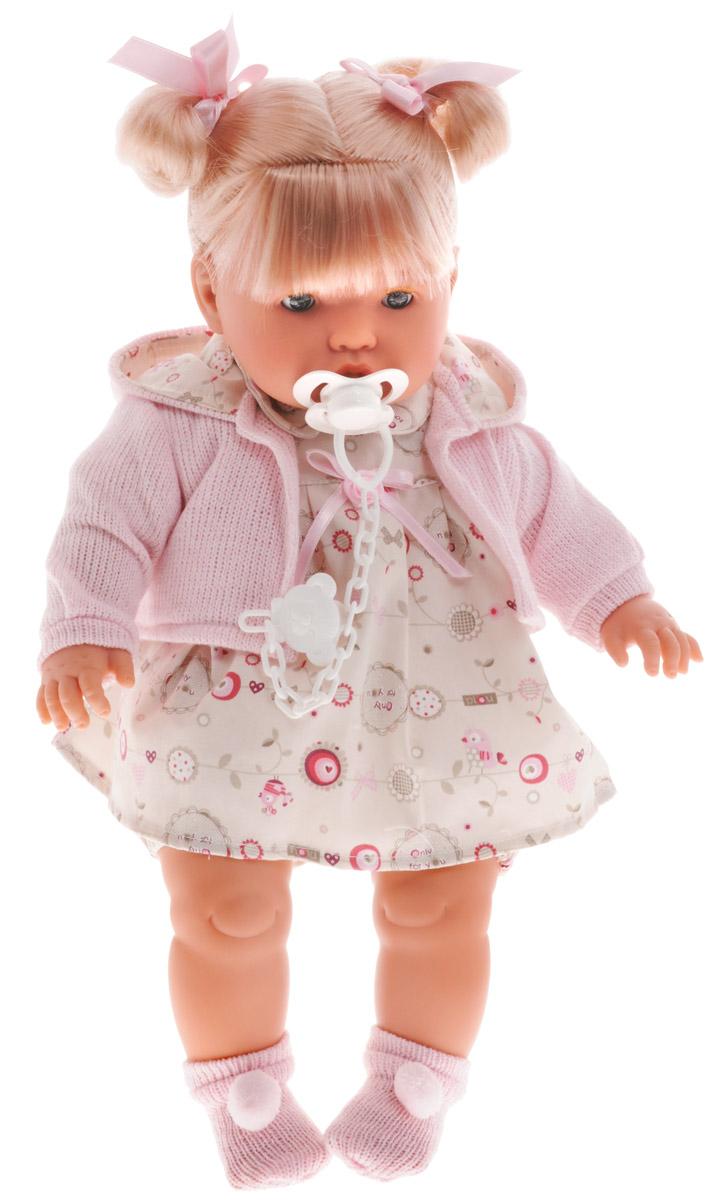 Llorens Пупс с пустышкойL 48226Пупс Llorens порадует вашу малышку и подарит массу положительных эмоций. Кукла выполнена с анатомической точностью и выглядит совсем как настоящий малыш. Ручки, ножки и голова малышки подвижны и изготовлены из высококачественного материала. Тело мягконабивное. Кукла одета в нарядное платье, розовую кофточку и носочки, которые легко снимаются с ножек. Волосы, убранные в высокие хвостики и перехваченные розовыми ленточками, при желании можно распустить. Также в набор входит пустышка. Игра с куклой учит детей проявлять заботу, доброту и выражать свои чувства.
