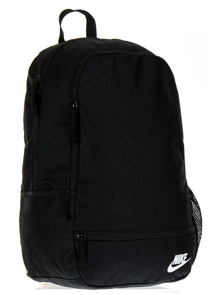 Рюкзак городской Nike Classic North - Solid, цвет: черный, 20 лBA5274-010Рюкзак Nike Classic North-Solid из плотного влагонепроницаемого полиэстера с высокой износостойкостью. Вместительное основное отделение с двойной молнией. Мягкие регулируемые лямки, боковой карман на молнии.