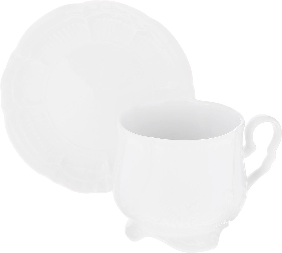 Чайная пара Фарфор Вербилок Кузнецовская, 2 предмета2633400БЧайная пара Фарфор Вербилок Кузнецовская состоит из чашки и блюдца, изготовленных из высококачественного фарфора. Изделия оформлены в классическом стиле и имеют изысканный внешний вид. Такой набор прекрасно дополнит сервировку стола к чаепитию и подчеркнет ваш безупречный вкус. Чайная пара Фарфор Вербилок Кузнецовская - это прекрасный подарок к любому случаю. Объем чашки: 350 мл. Диаметр чашки (по верхнему краю): 8 см. Высота чашки: 8,5 см. Диаметр блюдца: 14,5 см. Высота блюдца: 2 см.