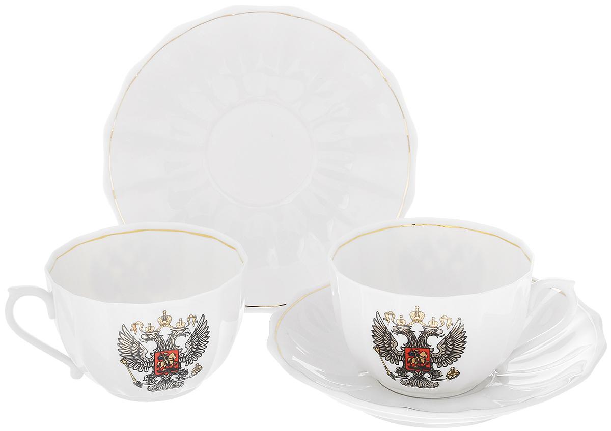 Набор чайный Фарфор Вербилок Герб России, 4 предмета2445780ПЧайный набор Фарфор Вербилок Герб России состоит из 2 чашек и 2 блюдец, изготовленных из высококачественного фарфора. Такой набор прекрасно дополнит сервировку стола к чаепитию, а также станет замечательным подарком для ваших друзей и близких. Объем чашки: 200 мл. Диаметр чашки (по верхнему краю): 9 см. Высота чашки: 5,5 см. Диаметр блюдца: 14,5 см. Высота блюдца: 2,5 см.