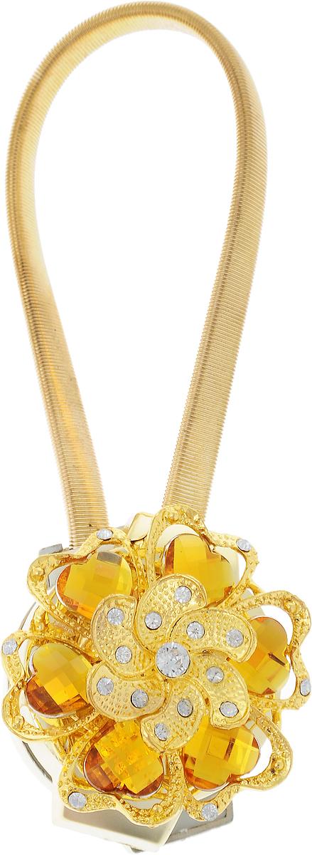 Подхват для штор TexRepublic Ajur. Rezinka, на магнитах, цвет: золотой. 7896378963Изящный подхват для штор TexRepublic Ajur. Rezinka, выполненный из пластика и металла, можно использовать как держатель для штор или для формирования декоративных складок на ткани. С его помощью можно зафиксировать шторы или скрепить их, придать им требуемое положение, сделать симметричные складки. Благодаря магнитам подхват легко надевается и снимается. Подхват для штор является универсальным изделием, которое превосходно подойдет для любых видов штор. Подхваты придадут шторам восхитительный, стильный внешний вид и добавят уют в интерьер помещения. Длина подхвата: 25 см. Диаметр: 4,5 см.