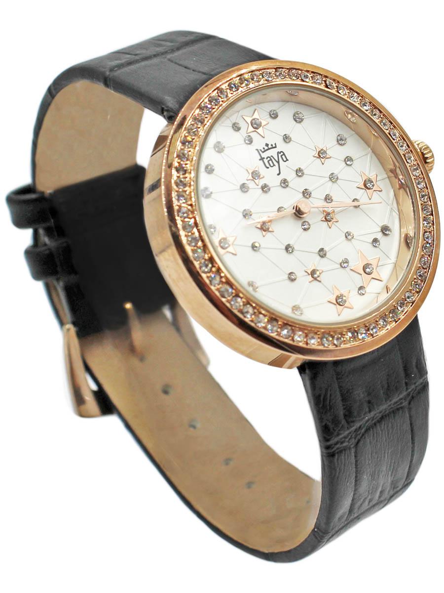 Наручные часы Taya, цвет: золотистый, черный. T-W-0039-WATCH-GL.BLACKT-W-0039-WATCH-GL.BLACKСтильные часы с серебряным циферблатом со стразами по окружности. Внутри имитация звездного неба с множеством созвездий. Часы наручные электронно-механические кварцевые, аксессуарные, с механической индикацией. Часовой механизм MORIOKA TOKEI inc., Сингапур с питанием от сменного кварцевого элемента питания типа LR626.