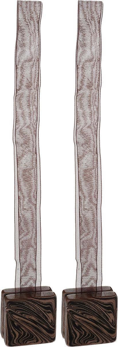Подхват для штор TexRepublic Ajur. Lenta, на магнитах, цвет: коричневый, 2 шт. 7902979029Изящный подхват для штор TexRepublic Ajur. Lenta, выполненный из пластика и текстиля, можно использовать как держатель для штор или для формирования декоративных складок на ткани. С его помощью можно зафиксировать шторы или скрепить их, придать им требуемое положение, сделать симметричные складки. Благодаря магнитам подхват легко надевается и снимается. Подхват для штор является универсальным изделием, которое превосходно подойдет для любых видов штор. Подхваты придадут шторам восхитительный, стильный внешний вид и добавят уют в интерьер помещения. Длина подхвата: 37 см. Количество: 2 шт.