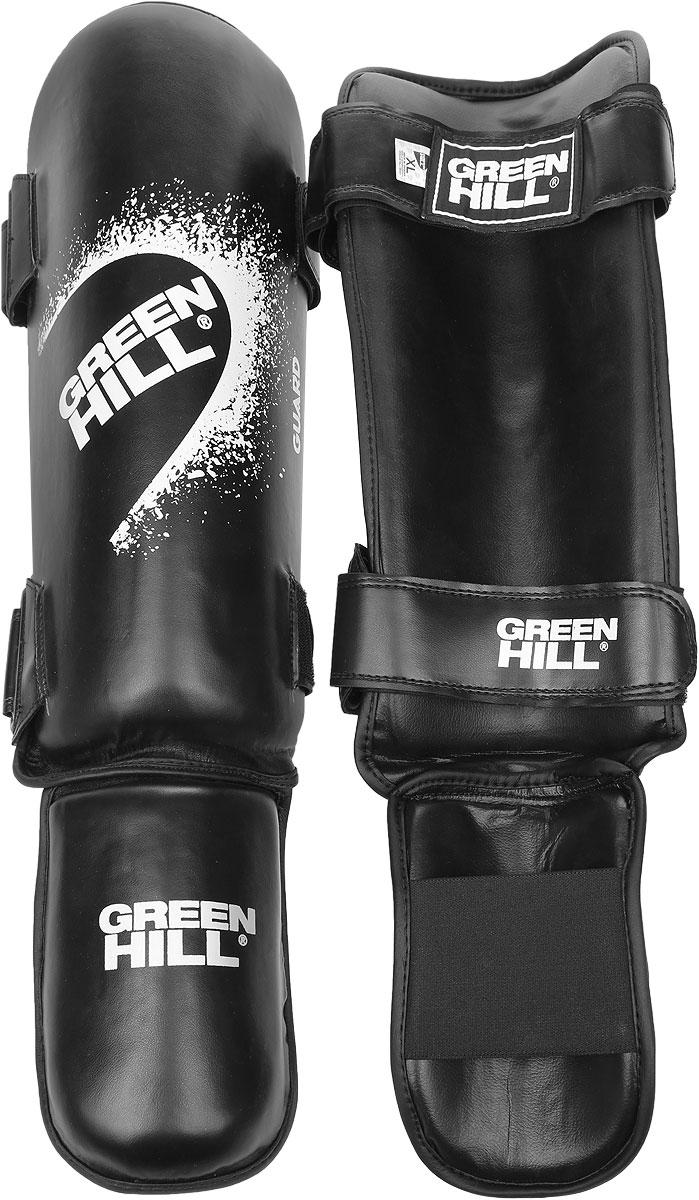 Защита голени и стопы Green Hill Guard, цвет: черный, белый. Размер XL. SIG-0012SIG-0012Защита голени и стопы Green Hill Guard с наполнителем, выполненным из вспененного полимера, необходима при занятиях спортом для защиты пальцев и суставов от вывихов, ушибов и прочих повреждений. Накладки выполнены из высококачественной искусственной кожи. Они прочно фиксируются за счет эластичной ленты и липучек. Удобные и эргономичные накладки Green Hill Guard идеально подойдут для занятий тхэквондо и другими видами единоборств. Длина голени: 37 см. Ширина голени: 13 см. Длина стопы: 17 см. Ширина стопы: 11,5 см.