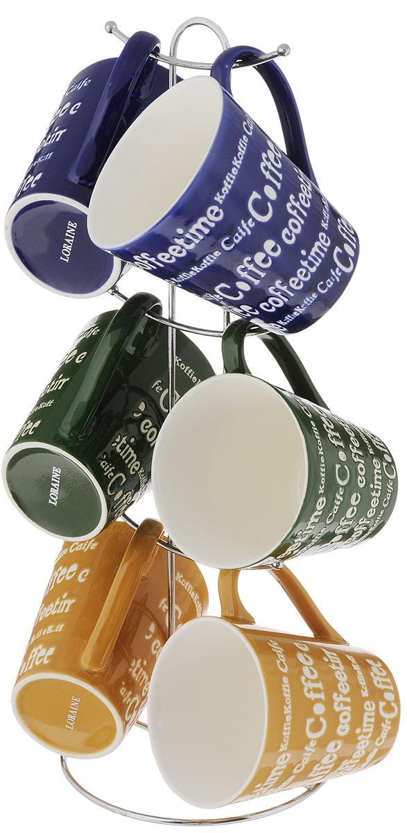 Набор кружек Loraine, цвет: желтый, синий, зеленый, 7 предметов. 2466224662_желтый, синий, зеленыйНабор Loraine состоит из 6 кружек и подставки. Кружки выполнены из высококачественной керамики с глазурованным покрытием. Теплостойкие ручки не позволяют обжечь руки во время чаепития. Для хранения кружек предусмотрена металлическая подставка с удобной ручкой для переноски. Яркий дизайн и качество исполнения сделают такой набор замечательным приобретением для вашей кухни. Можно использовать в микроволновой печи и мыть в посудомоечной машине. Диаметр кружки (по верхнему краю): 9 см. Высота кружки: 10 см. Объем кружки: 340 мл. Высота подставки: 38 см.