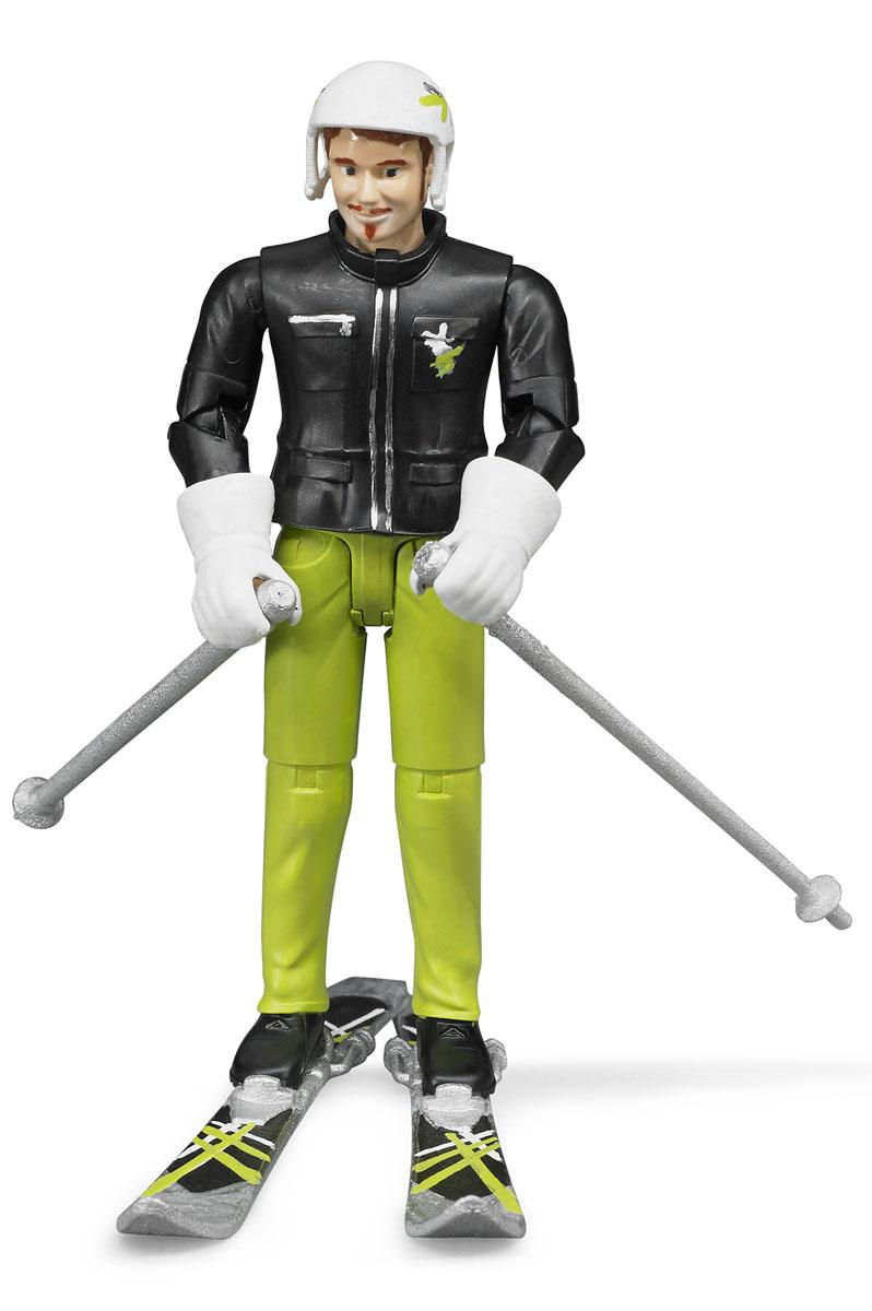 Bruder Фигурка Лыжник60-040Реалистичная фигурка лыжника Bruder представляет собой молодого человека спортивного вида в красивом костюме, в который входят черная куртка с замками и эмблемой на кармане и салатовые брюки с прошитыми полосами на коленях. Руки лыжника спрятаны в большие белые перчатки с отворотами, а на его голове надет удобный белый шлем. В одной руке лыжник держит палку, а во второй - лыжи и вторую палку. Лыжи широкие, с расположенными посередине креплениями, в которые удобно вставляются черные сапоги лыжника. Ребенок может взять игрушку на горку во двор, установить лыжника на лыжи и спустить с построенной снежной горки. Фигурку можно использовать в комплекте с лыжами или без них. Во время игры ребенок развивает свою фантазию, придумывая разнообразные сюжеты, он может представлять своего друга лыжника на известном лыжном курорте, спускать его с горы и наблюдать за движением, развивая внимание и концентрацию.