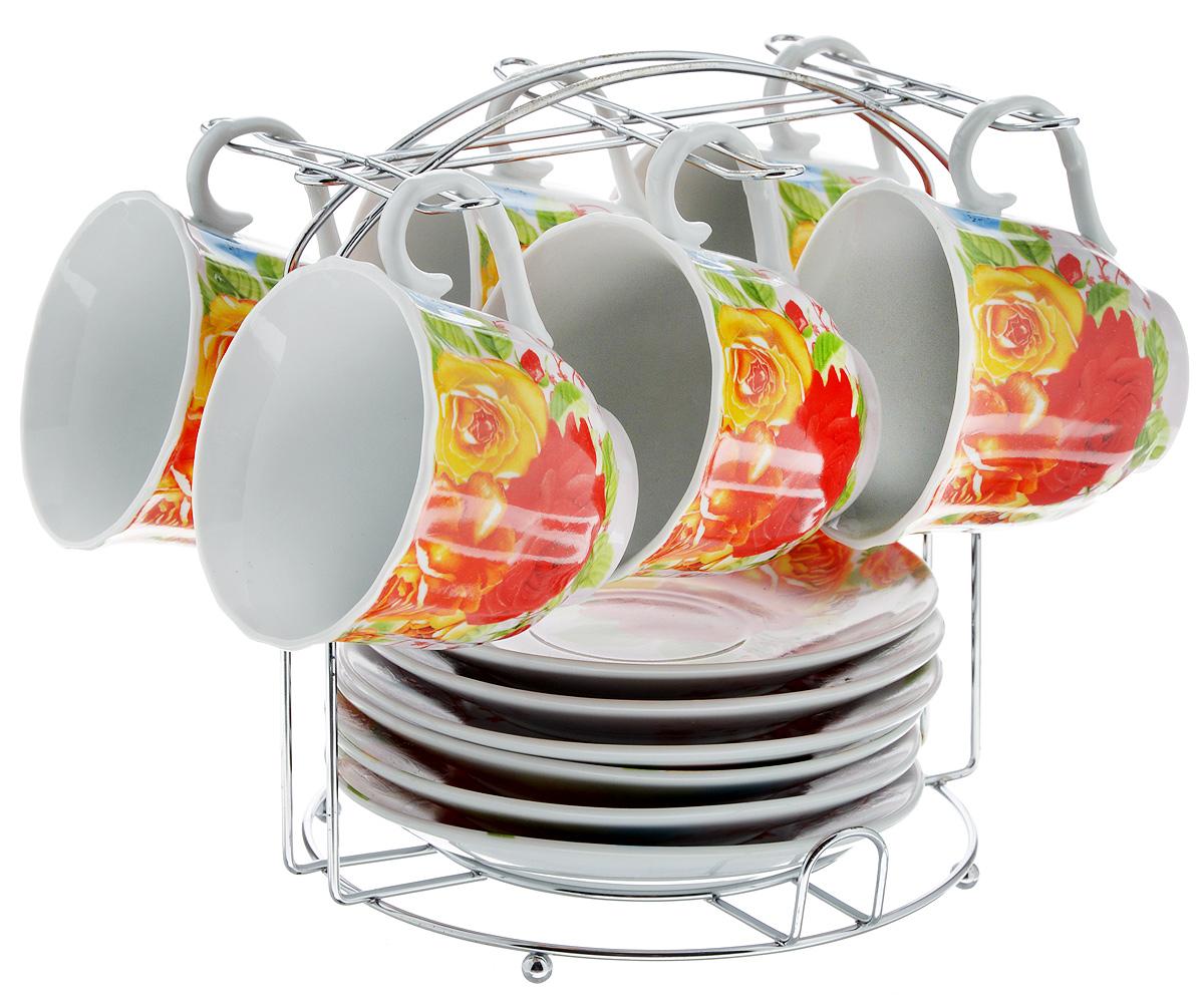 Набор чайный Bella, на подставке, 13 предметов. DL-F6MS-019DL-F6MS-019Набор Bella состоит из шести чашек и шести блюдец, изготовленных из высококачественного фарфора. Чашки оформлены красочным рисунком. Изделия расположены на металлической подставке. Такой набор подходит для подачи чая или кофе. Изящный дизайн придется по вкусу и ценителям классики, и тем, кто предпочитает утонченность и изысканность. Он настроит на позитивный лад и подарит хорошее настроение с самого утра. Чайный набор Bella - идеальный и необходимый подарок для вашего дома и для ваших друзей в праздники. Объем чашки: 220 мл. Диаметр чашки (по верхнему краю): 8 см. Высота чашки: 7 см. Диаметр блюдца: 14 см. Высота блюдца: 2 см. Размер подставки: 17,5 х 17 х 19,3 см.