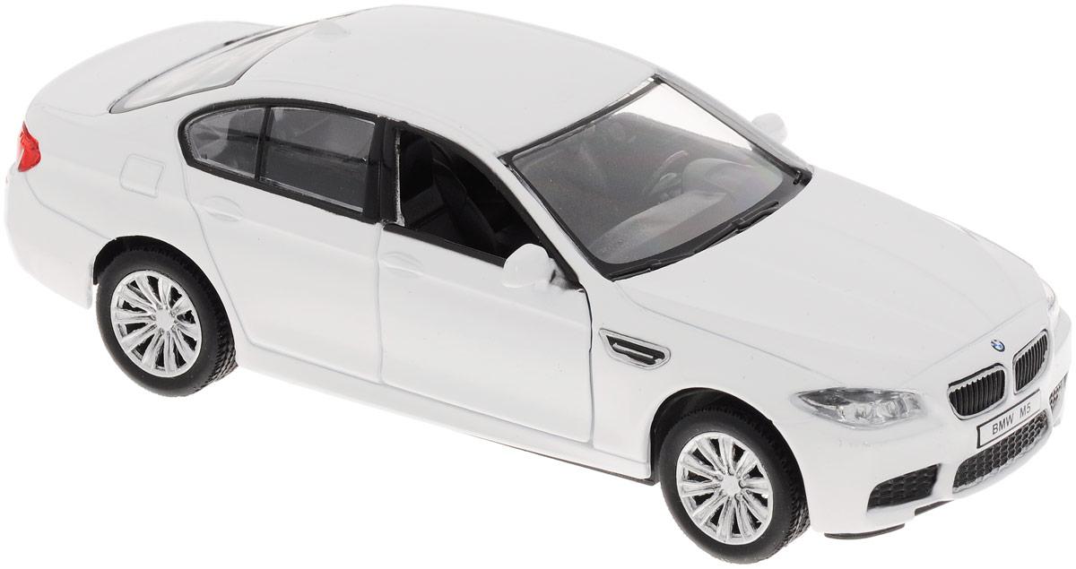 Рыжий Кот Модель автомобиля BMW M5 цвет белый масштаб 1:32И-1219_белыйМодель автомобиля Рыжий Кот BMW M5 - миниатюрная копия настоящего автомобиля в масштабе 1:32. Стильная модель привлечет к себе внимание не только детей, но и взрослых. Этот автомобиль, без сомнения, известен всем автолюбителям. Повышенную прочность модели обеспечивает металлический корпус. В оформлении использованы пластиковые элементы. Передние дверцы открываются. Машинка оснащена инерционным механизмом: достаточно немного отвести машинку назад, а затем отпустить, и она быстро поедет вперед. Такая модель станет отличным подарком не только любителю автомобилей, но и человеку, ценящему оригинальность и изысканность, а качество исполнения представит такой подарок в самом лучшем свете.