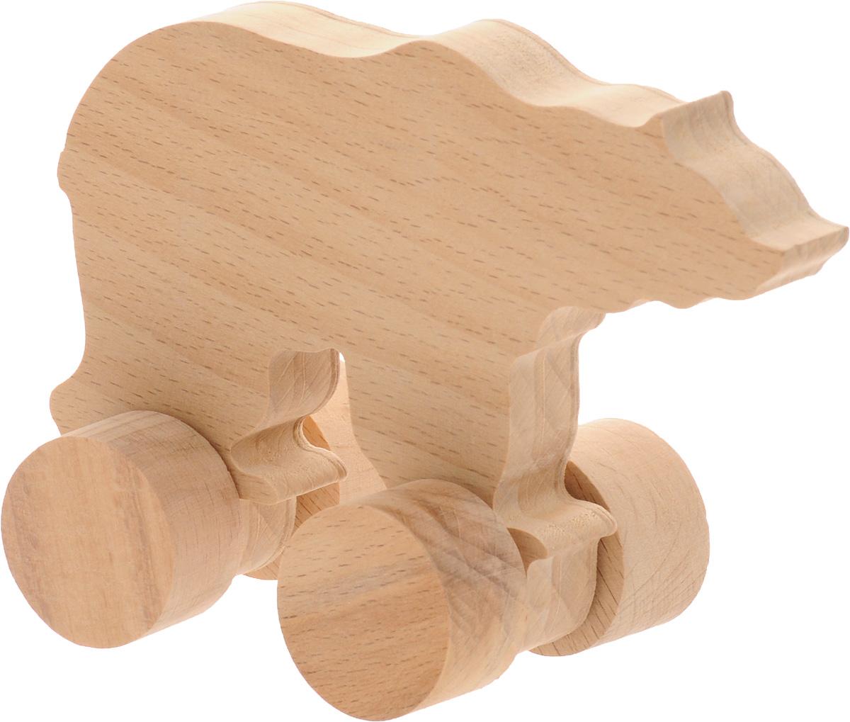 Волшебный городок Игрушка-каталка МедведьКМЕБДеревянная игрушка-каталка Волшебный городок Медведь развивает моторику ребенка, логику, пространственное мышление, зрительное восприятие и внимание малыша. Игрушка выполнена из высококачественного дерева, что абсолютно исключает вероятность травмирования. Понравится каждому малышу и станет хорошим подарком.