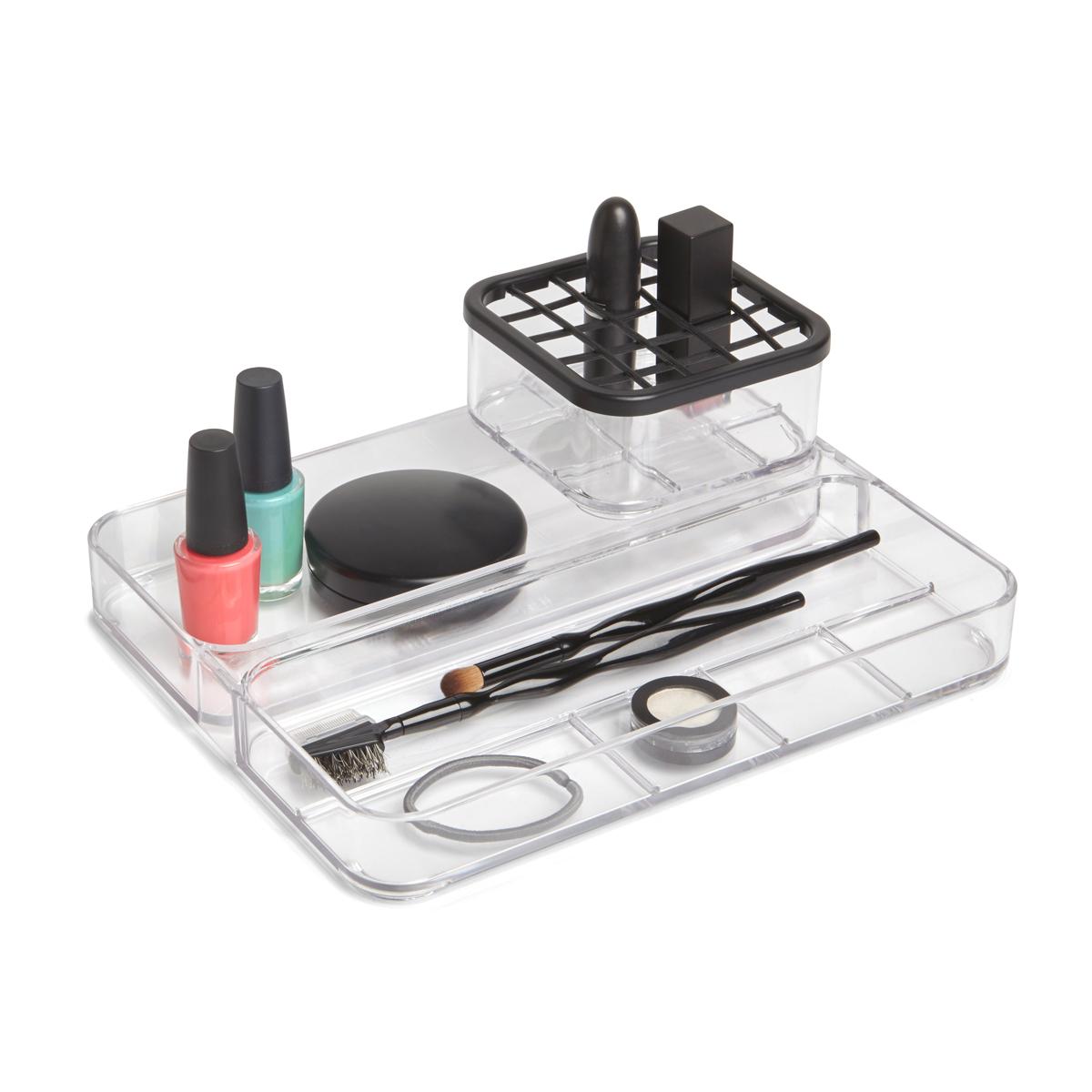 Органайзер Umbra Carrel, 2-уровневый, 5,2 х 10 х 25 см299604-165Практичный органайзер для хранения косметики, украшений или канцелярских принадлежностей. Контейнер, оснащенный крышкой с ячейками, подойдет для хранения карандашей, туши для ресниц или кисточек. На подставке-подносе разместятся украшения, лаки для ногтей, инструменты для маникюра. Прозрачные стенки помогут легко находить необходимый предмет.