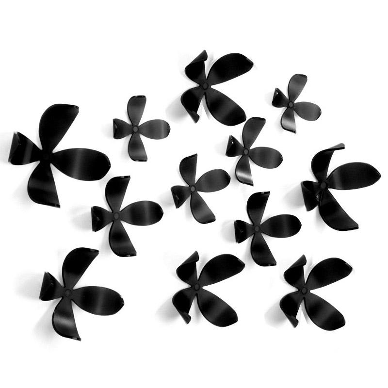 Декоративное украшение Umbra Wallflower, настенное, цвет: черный, 25 шт470040-040Пять минут - ровно столько понадобится, чтобы добавить изюминку интерьеру! Декоративное настенное украшение Umbra Wallflower выполнено из полипропилена в виде цветов. Они идеально подойдут к любому интерьеру, оживят и придадут шарм детском, гостиной, спальне, кабинеты или офису. Их очень легко крепить к стене и можно менять комбинацию и местоположение сколько угодно раз! В комплекте набор для крепления. Альтернатива крепежным гвоздикам - липучка Blue tag, которая прилагается к комплекту. В наборе 25 элементов. Пять разных размеров - от самого маленького 7 х 7 х 3 см, до самого большого 11 х 11 х 6 см.