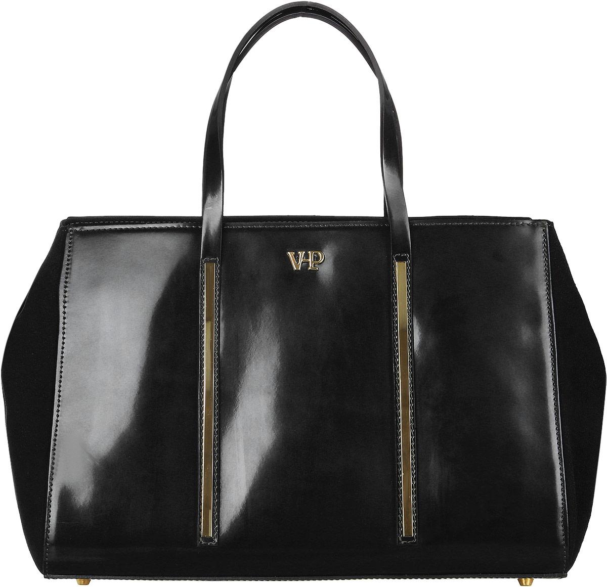 Сумка женская Vita Pelle, цвет: черный. 9VVP5129VVP512Стильная женская сумка Vita Pelle изготовлена из натуральной кожи. Изделие имеет одно вместительное отделение. Внутри расположены один открытый карман и два кармана на застежке-молнии. Закрывается изделие на застежку-молнию. Сумка оснащена наплечным ремнем регулируемым по длине. Изделие украшено металлической пластиной с названием бренда. Дно модели дополнено металлическими ножками.