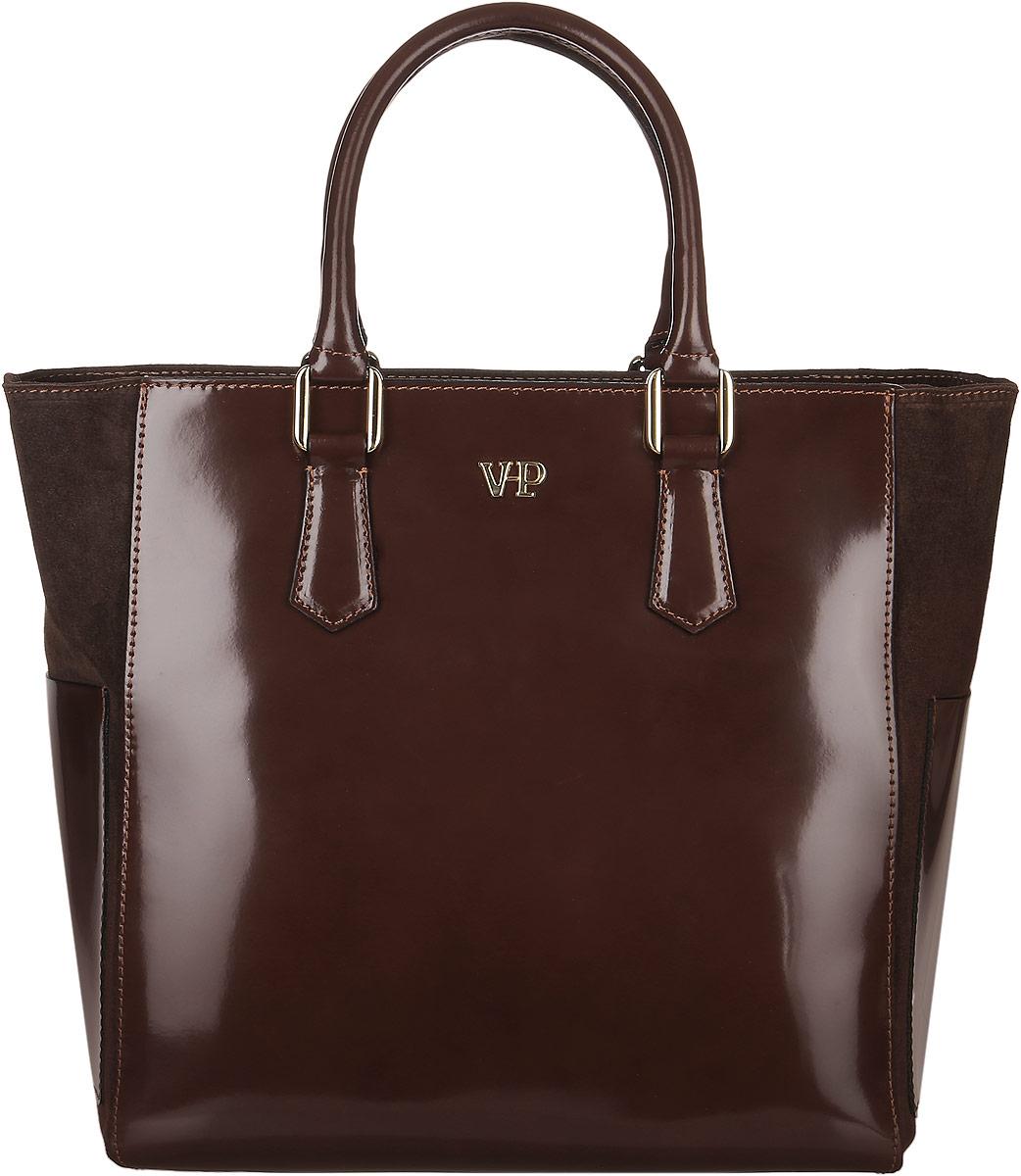Сумка женская Vita Pelle, цвет: коричневый. 9VVP5099VVP509Стильная женская сумка Vita Pelle изготовлена из натуральной кожи. Изделие имеет одно вместительное отделение. Внутри расположены один открытый карман и два кармана на застежке-молнии. Закрывается изделие на застежку-молнию. Изделие украшено металлической пластиной с названием бренда.