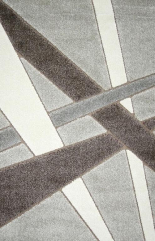 Ковер Oriental Weavers Леа, цвет: коричневый, 80 х 140 см. 1491014910Двухуровневая современная технология cut&loop делает объемными дизайны ковров этой коллекции, что позволяет использовать их в самых современных интерьерах.