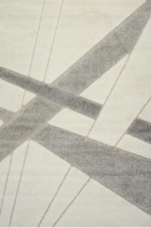 Ковер Oriental Weavers Леа, цвет: коричневый, 80 х 140 см. 1491314913Двухуровневая современная технология cut&loop делает объемными дизайны ковров этой коллекции, что позволяет использовать их в самых современных интерьерах.