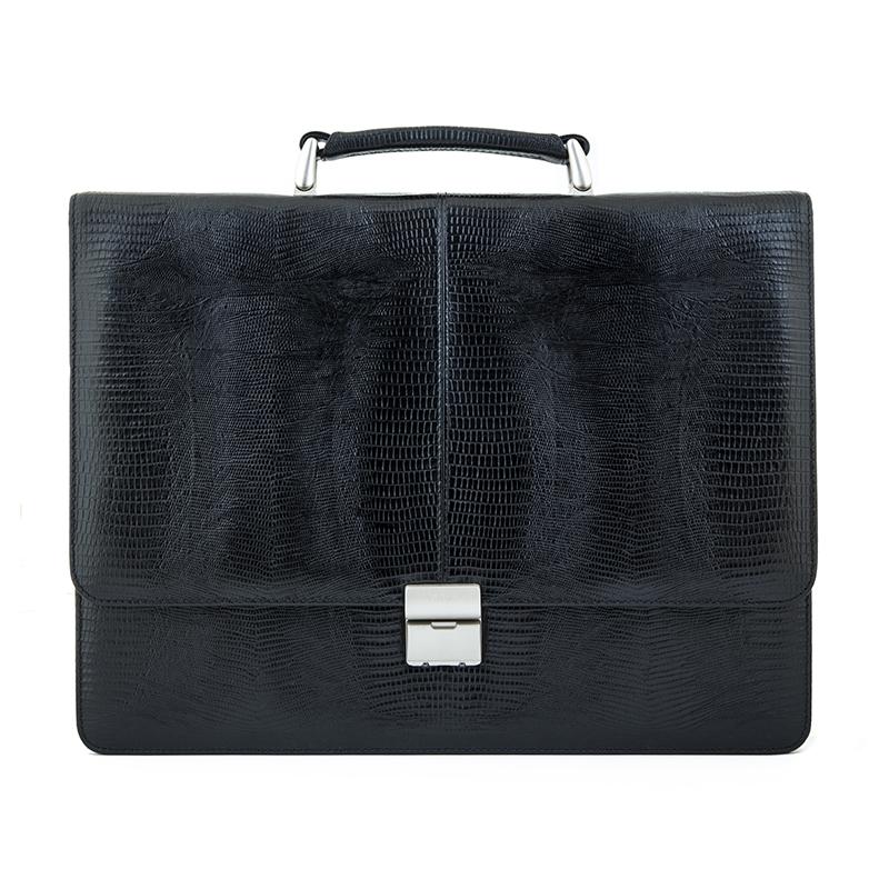 Портфель мужской Petek 1855, цвет: черный. 777.041.01777.041.01 BlackМужской кожаный портфель Petek черного цвета, обладает фактурой под рептилию. 1 отделение, 3 кармана для бумаг, отделение на молнии.
