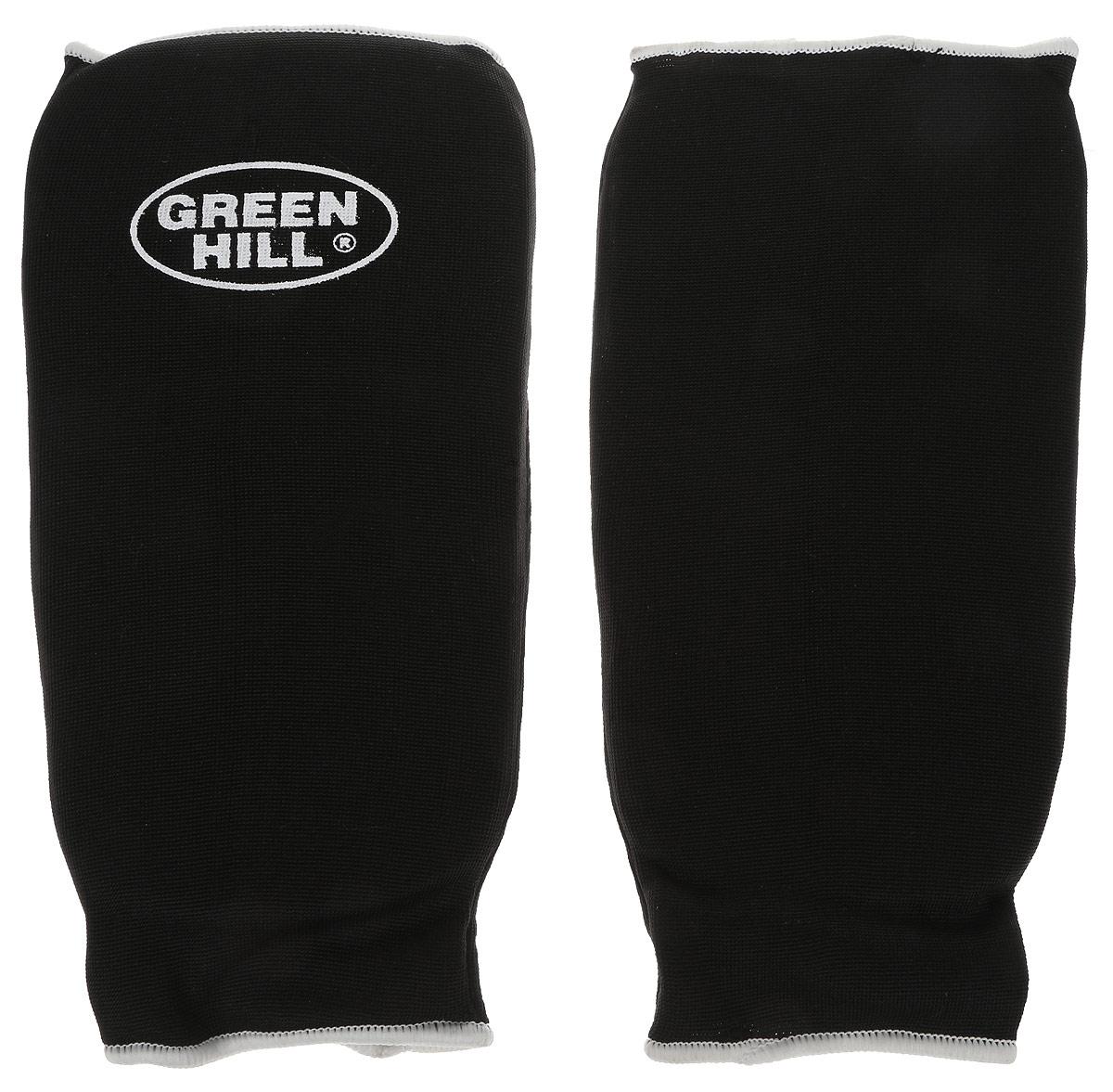 Защита голени Green Hill, цвет: черный, белый. Размер L. SPC-6210SPC-6210Защита голени Green Hill с наполнителем, выполненным из вспененного полимера, необходима при занятиях спортом для защиты суставов от вывихов, ушибов и прочих повреждений. Накладки выполнены из высококачественного эластана и хлопка. Длина голени: 28 см. Ширина голени: 16 см.