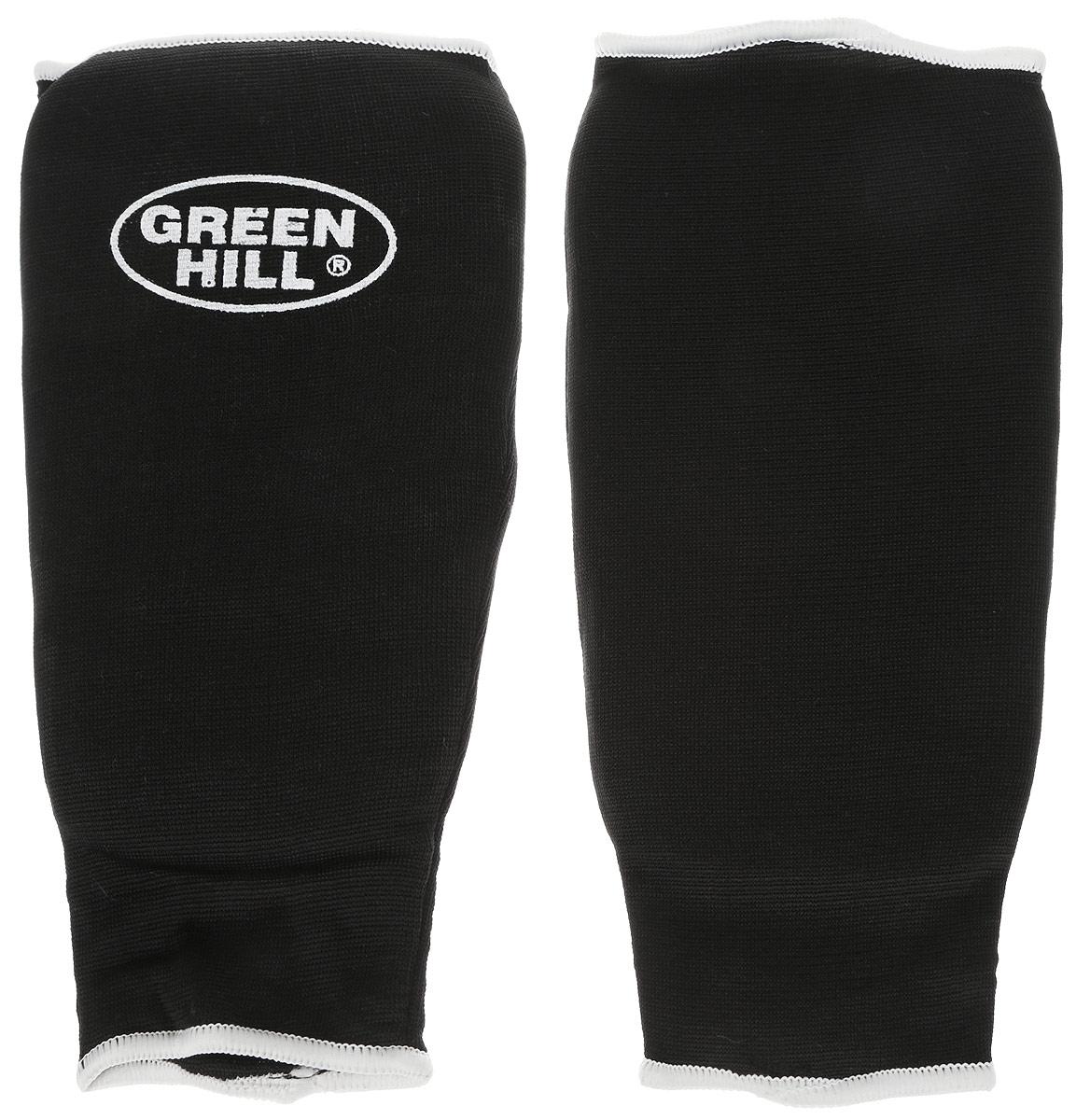 Защита голени Green Hill, цвет: черный, белый. Размер S. SPC-6210SPC-6210Защита голени Green Hill с наполнителем, выполненным из вспененного полимера, необходима при занятиях спортом для защиты суставов от вывихов, ушибов и прочих повреждений. Накладки выполнены из высококачественного эластана и хлопка. Длина голени: 23,5 см. Ширина голени: 14 см.