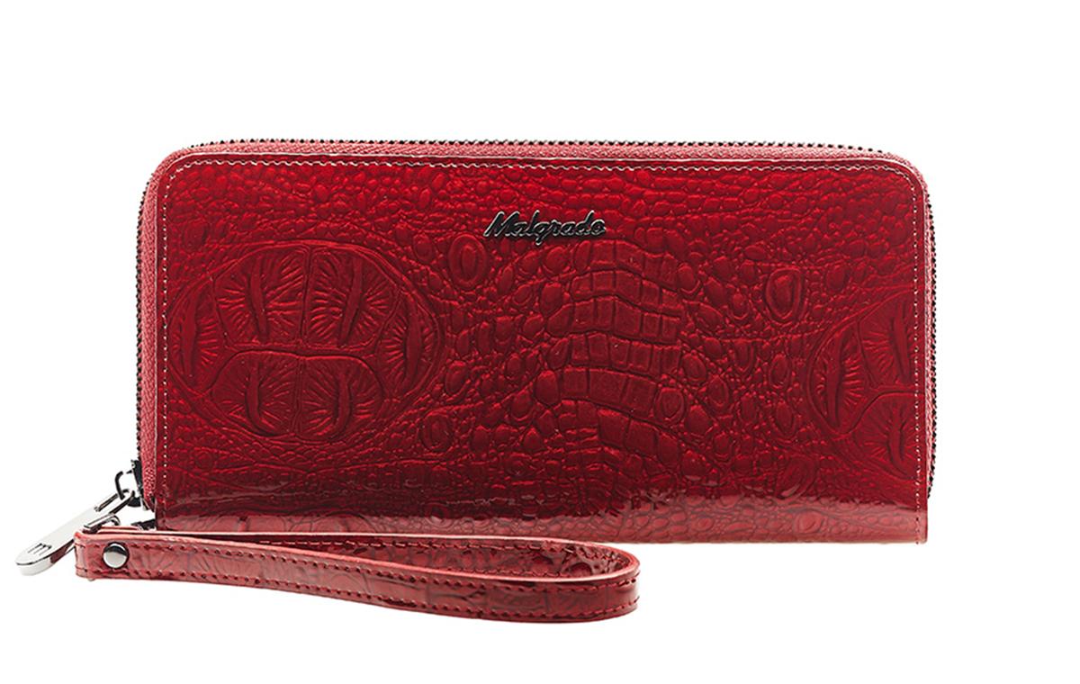 Кошелек Malgrado, цвет: красный. 73005-0170173005-01701# Red Клатч MalgradoСтильный кошелек Malgrado изготовлен из лаковой натуральной кожи красного цвета с тиснением под рептилию и закрывается на молнию. Внутри расположены четыре основных отделения, одно из которых на молнии, по четыре кармашка на боковых стенках для карточек, визиток, кредиток и два кармашка побольше, в которые можно положить пропуск, проездной билет или фотографию. В комплект также входит кожаный ремешок для удобной переноски. Кошелек упакован в фирменную коробку с логотипом фирмы.