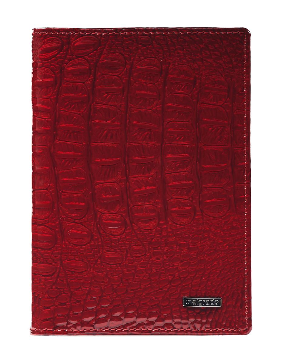 Обложка для паспорта женская Malgrado, цвет: красный. 54019-0170154019-01701 RedСтильная обложка для паспорта Malgrado выполнена из натуральной лакированной кожи с тиснением под рептилию и оформлена металлической фурнитурой с символикой бренда. Изделие раскладывается пополам. Внутри расположены два накладных кармана, один из которых дополнен прозрачной вставкой из пластика, и пять накладных кармашков для пластиковых карт или визиток. Изделие дополнено съемным блоком для хранения автодокументов. Блок включает в себя четыре стандартных файла, один файл для хранения водительского удостоверения и один файл формата А3. Обложка для паспорта поставляется в фирменной упаковке. Обложка для паспорта поможет сохранить внешний вид ваших документов и защитит их от повреждений, а также станет стильным аксессуаром, который подчеркнет ваш образ.
