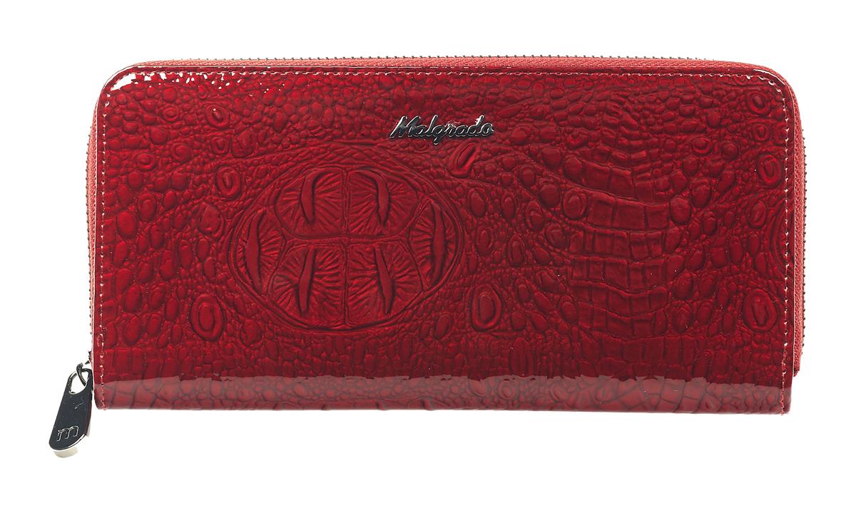 Кошелек женский Malgrado, цвет: красный. 77006-0170177006-01701 RedСтильный женский кошелек Malgrado выполнен из натуральной лакированной кожи с тиснением под рептилию и оформлен металлической фурнитурой с символикой бренда. Изделие закрывается на круговую застежку-молнию. Внутри расположены четыре отделения для купюр, отделение для монет на молнии, два накладных кармана, девять накладных карманов для пластиковых карт, один из которых дополнен прозрачной вставкой из пластика. Изделие поставляется в фирменной упаковке. Кошелек Malgrado станет отличным подарком для человека, ценящего качественные и практичные вещи.