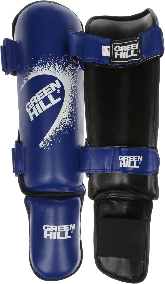 Защита голени и стопы Green Hill Guard, цвет: синий, белый. Размер XL. SIG-0012SIG-0012Защита голени и стопы Green Hill Guard с наполнителем, выполненным из вспененного полимера, необходима при занятиях спортом для защиты пальцев и суставов от вывихов, ушибов и прочих повреждений. Накладки выполнены из высококачественной искусственной кожи. Они прочно фиксируются за счет эластичной ленты и липучек. Удобные и эргономичные накладки Green Hill Guard идеально подойдут для занятий тхэквондо и другими видами единоборств. Длина голени: 36 см. Ширина голени: 14 см. Длина стопы: 16,5 см. Ширина стопы: 11 см.