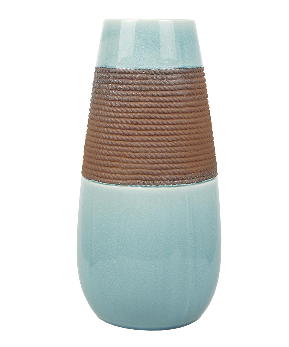 Ваза Этажерка Coletta, цвет: голубой, коричневый, высота 36 смL116-2Ваза Этажерка Coletta выполнена из высококачественной керамики и имеет изысканный внешний вид. Такая ваза станет идеальным украшением интерьера и прекрасным подарком к любому случаю. Высота вазы: 36 см.