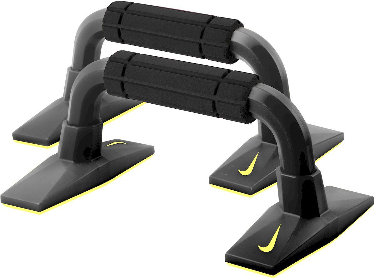 Упоры для отжиманий Nike Push Up Grip 2.0, цвет: черный, желтый, 2 штN.ER.09.007.NSУпоры для отжиманий Nike Push Up Grip 2.0 выполнены из полипропилена и резины. Традиционную технику выполнения отжиманий можно существенно дополнить, используя упоры для отжиманий - эффективный инструмент, который позволяет развивать и укреплять мышцы рук, груди и плечевого пояса, развивает выносливость. Приподнятая позиция дает возможность совершать разнообразные упражнения для укрепления грудных и плечевых мышц, трицепсов. Широкие основания обеспечивают надёжную устойчивость. Эргономичный дизайн снижает давление на запястья. Порадуйте себя полезным и прочным тренажером. Размер упора (в собранном виде): 27 х 16 х 12 см.