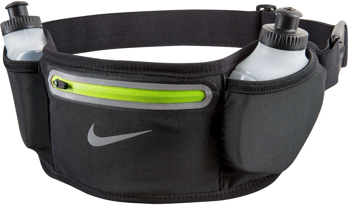 Пояс для бега Nike Lean 2 Bottle Waistpack, с 2 бутылками для воды, цвет: черный, 180 млN.RL.57.023.OSСостав: Основа: 55% полиэстер, 45% нейлон, подкладка: 100% нейлон - Регулируемый эластичный ремешок обеспечивает надежную комфортную посадку во время тренировки - Растяжимый эластичный сетчатый материал обеспечивает требуемое пространство для хранения - Низкая и надежная посадка предотвращает смещение - Застежка позволяет быстро снимать и одевать сумку - 2 бутылки в комплекте объемом 180 мл - Светоотражающие детали повышают видимость при слабом освещении
