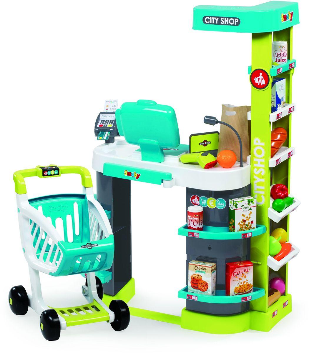 Smoby Игровой набор City Shop350207Игровой набор Smoby City Shop представляет собой кассу-прилавок со всеми атрибутами настоящего супермаркета. С таким набором ребенок может организовать увлекательную сюжетно-ролевую игру, в которой он представит себя опытным продавцом или покупателем. В наборе имеются все необходимые предметы для осуществления торговой деятельности. Касса-прилавок имеет несколько полок, на которых расставлены товары для продажи. Покупатель может выбрать товар и положить его в удобную тележку с регулируемой ручкой, на которой расположен замок с монетой для блокировки. В комплекте имеются весы, с помощью которых можно взвешивать продуктовые товары. Товары можно сканировать на кассе, при этом раздастся характерный для этого действия звук. Кроме того, в наборе имеется терминал для приема оплаты через пластиковые карты и различные дополнительные предметы, такие как денежные купюры, монеты, пакеты для упаковки товаров. В комплект входят: касса с прилавками, тележка, 4 коробочки, кабачок, морковь,...