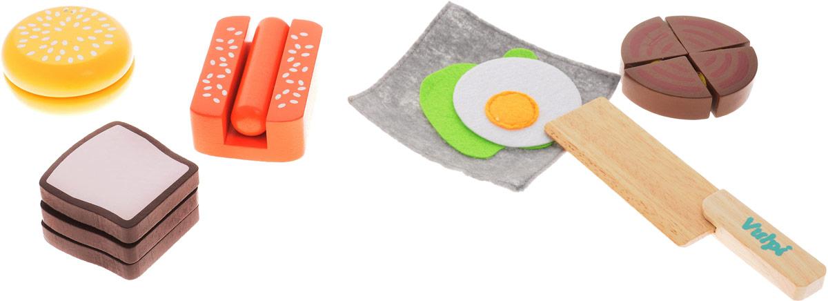 Vulpi Игрушечный набор Завтрак17013Игровой набор Vulpi Завтрак, несомненно, привлечет внимание вашей малышки и не позволит ей скучать. Набор включает в себя игрушечные продукты (хотдог, бургер, тосты), а также нож для нарезки. Все предметы изготовлены из высококачественного дерева. Для имитации нарезки каждый продукт состоит из разъединяющихся частей на липучках. Набор окрашен в яркие цвета нетоксичными, безопасными красками. Увлекательная игра поможет развить вашему ребенку воображение и фантазию, мелкую моторику рук. С этим набором маленькая хозяйка будет часами занята интересной игрой и сможет вкусно накормить всех своих кукол.