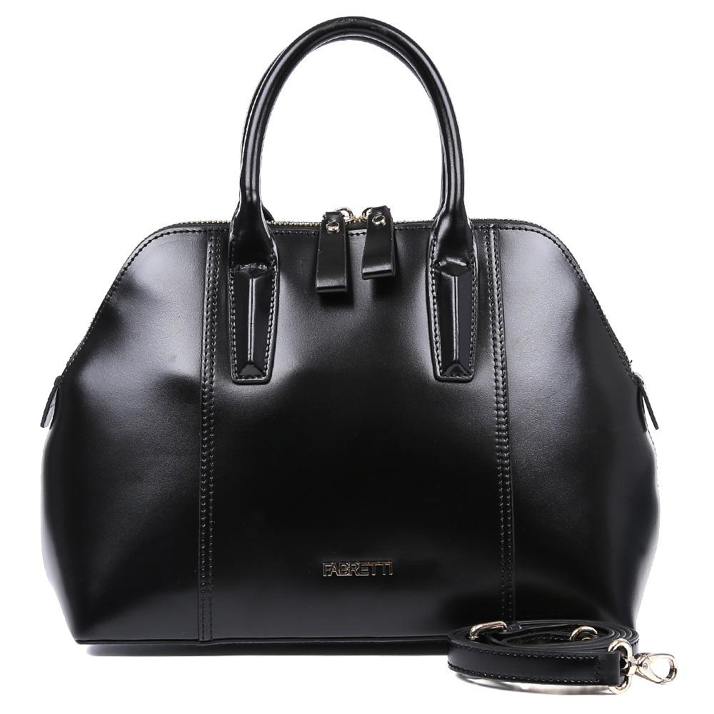 Сумка женская Fabretti, цвет: черный. S1758S1758-blackНероятно стильная женская сумка от итальянского бренда Fabretti выполнена из натуральной плотной кожи, которая держит форму и имеет мягкую фактуру. Классический черный цвет изделия в сочетании с золотой фурнитурой придают модели неповторимую изысканность и элегантность. Тонкие ручки и стильная строчка превращают сумку в изящный аксессуар, который подойдет, как для повседневных, так и для вечерних образов. Внутри сумки вы с легкостью расположите свой сотовый телефон и другие женские мелочи с помощью удобных отделений. Изделие закрывается на молнию с роскошными кожаными поводками, вмещает формат A4. В комплекте аксессуар имеет тонкий кожаный ремешок, с помощью которого, вы сможете стать самой неотразимой и стильной в любой компании.