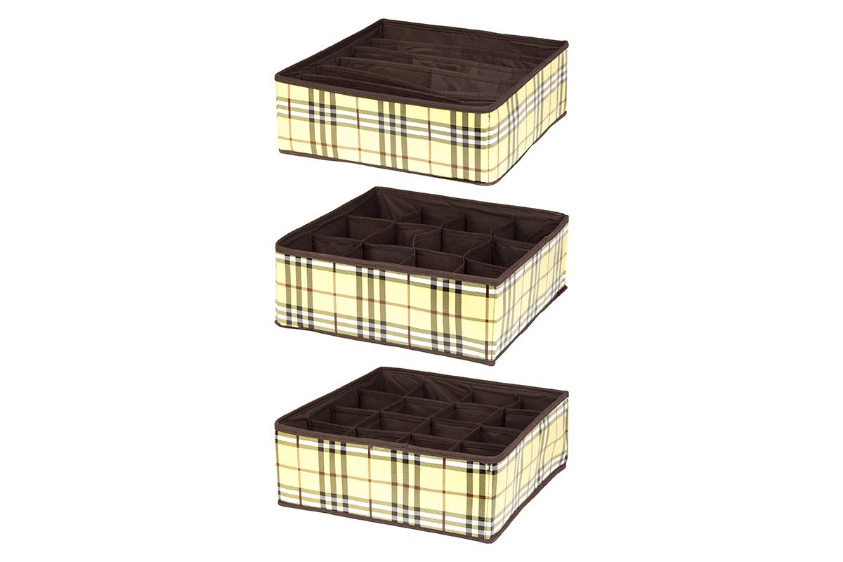 Набор кофров для хранения EL Casa Шотландка, 32 х 32 х 12 см, 3 шт370509Набор EL Casa Шотландка состоит из трех кофров для хранения. Кофры выполнены из качественного полиэстера, который обеспечивает естественную вентиляцию, отлично пропускает воздух, но не пропускает пыль. Благодаря специальным вставкам из картона кофры прекрасно держат форму. Все кофры содержат разное количество секций. Первый кофр содержит 16 секций для хранения носков и трусов, второй - 12 секций, а третий - 6 продолговатых секций, которые идеальны для бюстгальтеров. Для удобства использования кофры не имеют крышки. Изделия декорированы рисунком в клетку и имеют оригинальный дизайн. Легко складываются и раскладываются. Они помогут хранить вещи компактно и удобно. Подходят для размещения в шкафу, комоде.